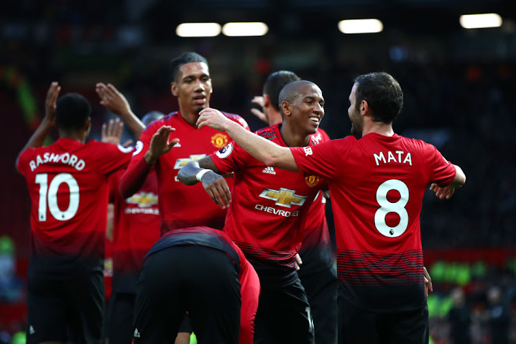 Juan Mata of Manchester United celebrates after scoring his team's second goal with his team mates during the Premier League match between Manchester United and Fulham FC at Old Trafford on December 8, 2018 in Manchester, United Kingdom.