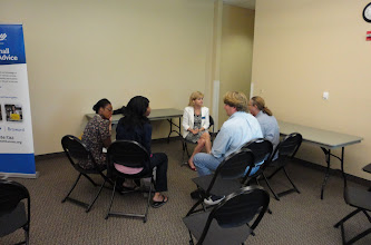 Photo: Volunteer Nancy Leve doing group counseling