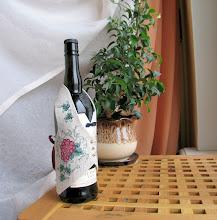Photo: Derwentwater, жилет на бутылку виски. Прикладная вышивка. Шила по набору. Поменяла ленточку, подкладку у жилета (ну как без замен-то), да и сам жилет надет на бутылку из под портвейна.