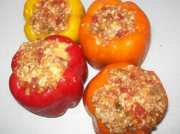Fill the bell peppers with the meat and put into a crock pot.