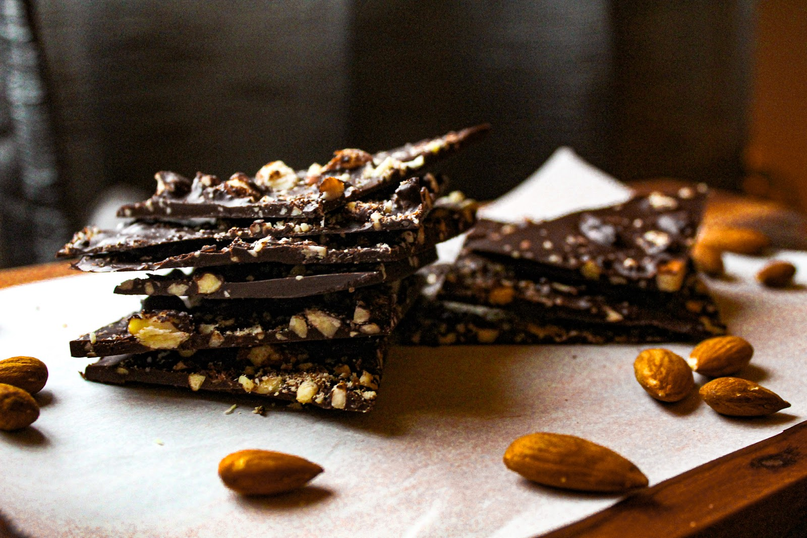 Chocolate almond bark in pieces on a table