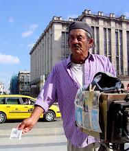 Photo: man using vintage camera. havana, cuba. Tracey Eaton photo