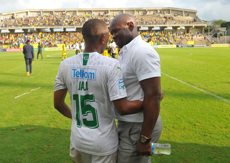 Andile Jali shares a light moment with coach Steve Komphela after the match.