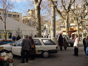 Photo: On the way to the Old Town, we pass by the market square, which is busy even on this unseasonably chilly day.
