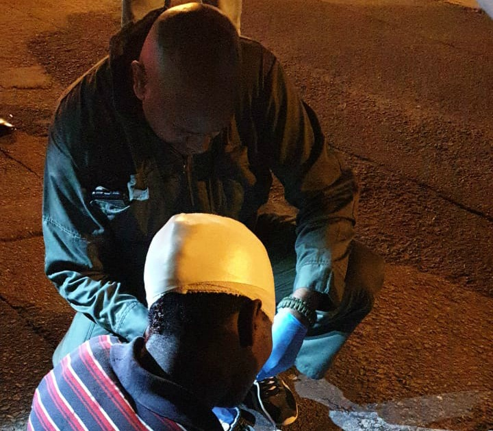 A paramedic working with the Mayville community policing forum helps a foreign national who was hurt during violence on Tuesday in Sydenham, Durban.