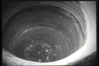 Photo: A partial double exposure of the inside of the pot with a shovel of soil in the bottom and the siding of the house showing through the top of the film. I was definitely thinking I'd be making more films then pots at the time this was taken.