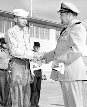 Photo: Capt. Duffy presents Fire Ax to outstanding crash crew section for the month of October, 1958 to Perry Murphy AB2
