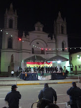 Photo: Local dignitaries seated in front of the church.