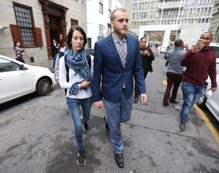 Henri van Breda arrives with his girlfriend, Danielle Janse van Rensburg, on judgment day at the Cape Town High Court - 21 May 2018.