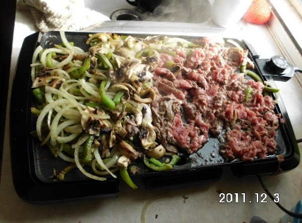 Season and cook ribeye on a griddle, grill or skillet.Slice and cook poblano and...