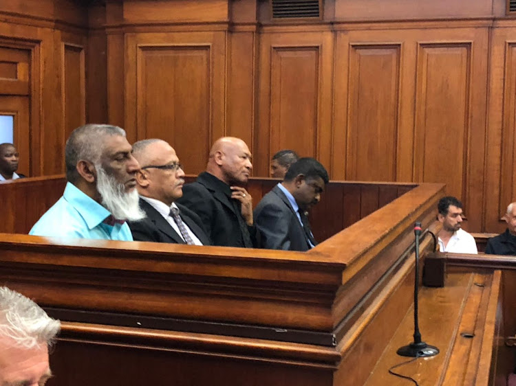 Former Western Cape police commissioner Arno Lamoer, second left, in the dock at the high court in Cape Town with Salim Dawjee, Darius van der Ross and Colin Govender