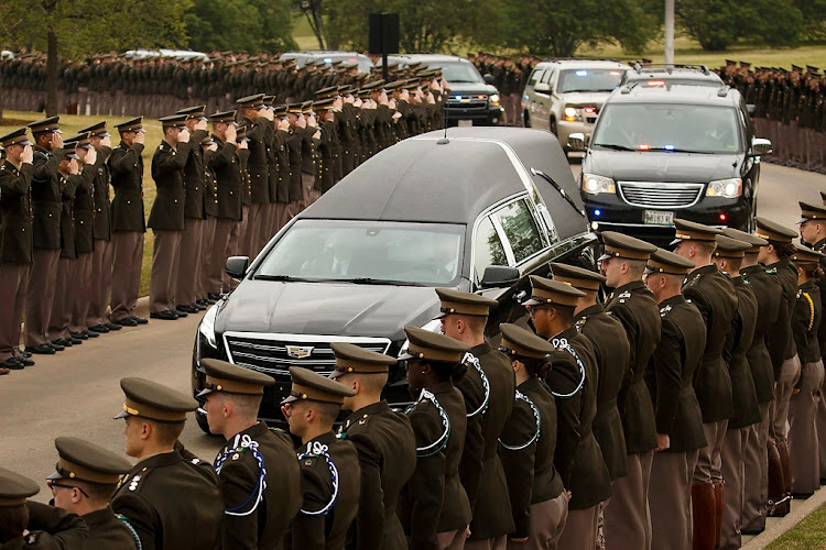 The hearse carrying former first lady Barbara Bush passes through members of the Texas A&M Corps of Cadets as it nears her husband's presidential library at the university in College Station, Texas, April 21 2018. Picture: REUTERS