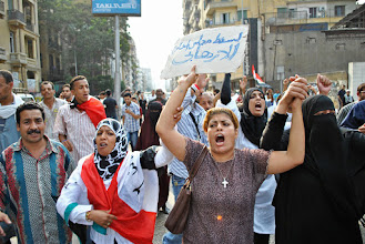 Photo: Muslim and Christian women holding hands in a united front against the SCAF.