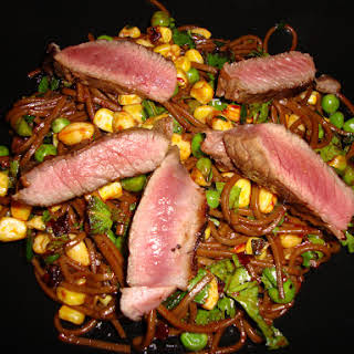Marinated Seared Steak on a Pea, Sweetcorn and Herb Buckwheat Noodle Salad with a Black Bean Dressing.