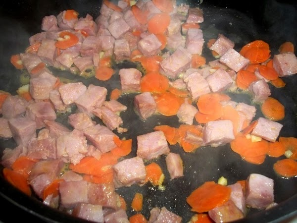 In a large skillet over medium heat, melt butter and add the carrots, garlic...