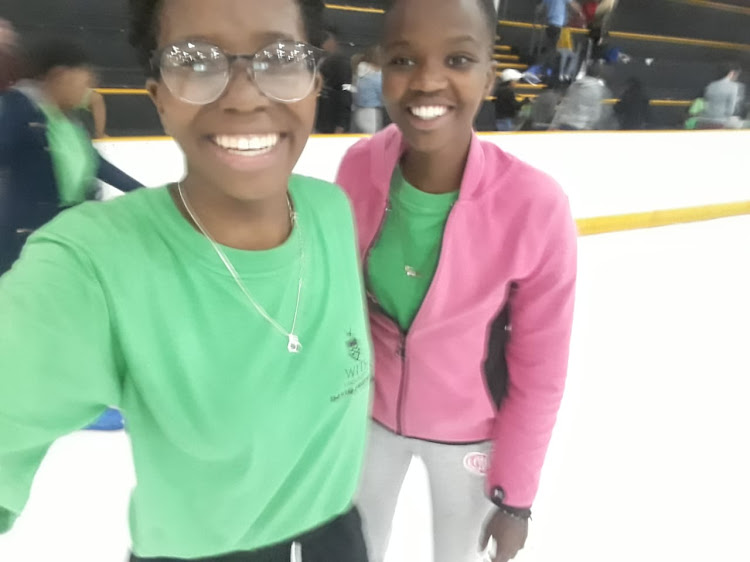 Yonela Zatshikila and Asithandile Kwasa'o Lugalo during an outing to the ice rink at Northgate Mall.