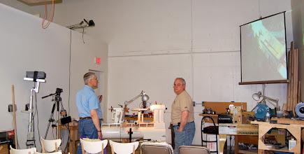 Photo: Bert Bleckwenn explains the current video setup to regular videographer Mark Verna.