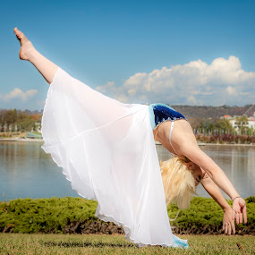 Dance near Lake by Loi Huynh - People Fashion ( swinging, excitement, dancing, gesturing, joy, fun, adult, woman dancing, people, girls dancing, caucasian, traditional culture, sports and fitness, human leg, event, performing arts event, action, exhibition, symmetry, lifestyles, ballet, anticipation )