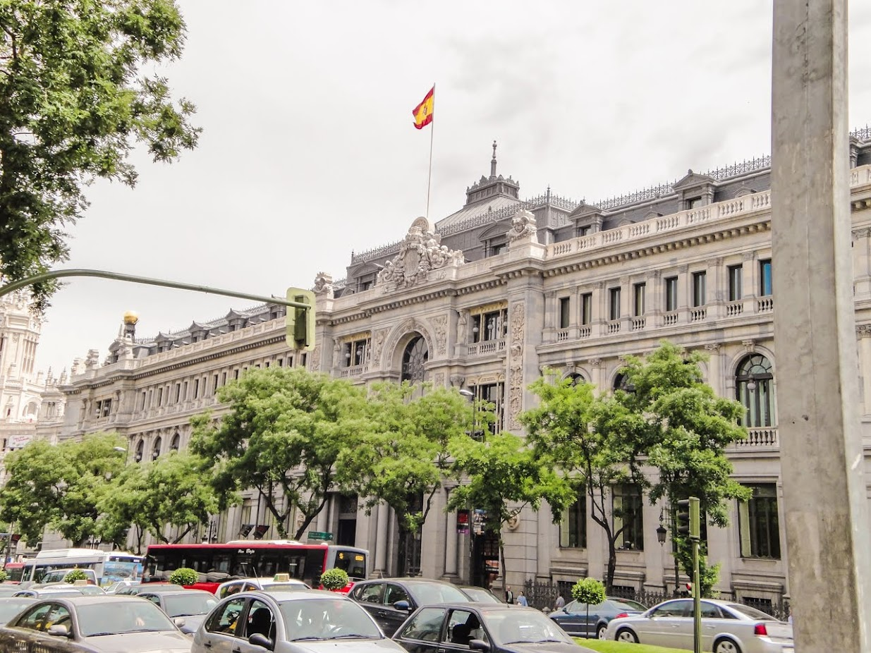The Spanish Flag waving atop a building