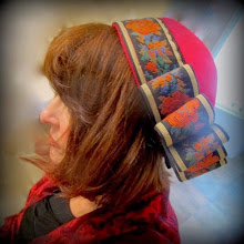 Photo: <KAPELUXE> Unique-Chique Hats by Luba Bilash ART & ADORNMENT  Tomato red wool felt base, vintage machine-embroidered ribbon, 360 degree possibilities. Can also be worn on an angle. Size L - 56 cm/22 in $90 SOLD  Model: Char V