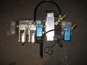 Photo: standard configuration of: filter drier, air-oiler, dual soleniod main gate valve, and safety lock valves