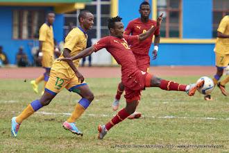 Photo: Harrison Afful (12) intercepts the ball ahead of Jean-Claude IRANZI (12)[Rwanda Vs Ghana AFCON2017 Qualifier, 5 Sep 2015 in Kigali, Rwanda.  Photo © Darren McKinstry 2015
