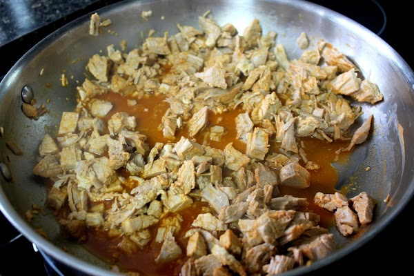 Heat the pork in a large pan over medium heat with stock and hot...