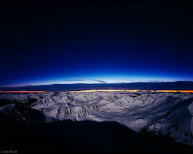 Photo: Moonlit mountains and the last colors of sunset, as seen from the summit of Mt. Elbert, the tallest mountain in Colorado at 14,440 feet, Sawatch Range, February. I spent three hours on the snowy summit on this calm winter night, in awe of our planet, before I made my way down under the moonlight.