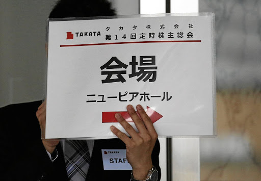 A staff member of Japanese car parts maker Takata holds a signboard at the company's annual general meeting in Tokyo, Japan, on June 27 2017, following the company's filing for bankruptcy protection. File picture: REUTERS