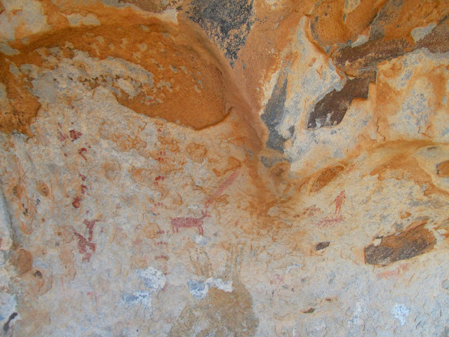 Pictograph panel on an overhanging boulder