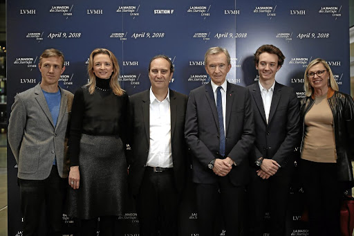 LVMH executives at the inauguration of the Station F startup accelerator in Paris on April 9 2018. From left, chief digital officer Ian Rogers, board member Delphine Arnault, Station F founder Xavier Niel, LVMH CEO Bernard Arnault, TAG Heuer executive Frederic Arnault, and group vice-president Chantal Gaemperle. Picture: REUTERS