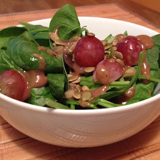 Spinach Salad with Pumpkin Seeds and Grapes.