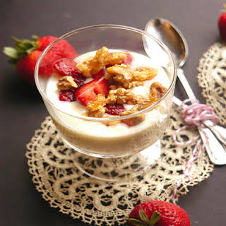 Creamy Vanilla Pudding with Balsamic Macerated Strawberries and Candied Walnuts.
