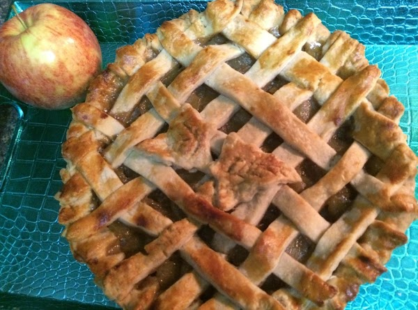 """Dot with bits of butter. Cut second pie crust into 1"""" strips, create a..."""