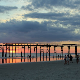 After the Storm by Christine Urick - Buildings & Architecture Bridges & Suspended Structures ( oak island pier, sunset party  oak island nc, eastern shore sunset nc, sunset oakisland pier, peaceful sunset after florence,  )
