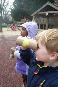 "Young children go birdwatching with cardboard tube ""binoculars""."