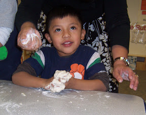Children love to make, feel, and shape play dough.