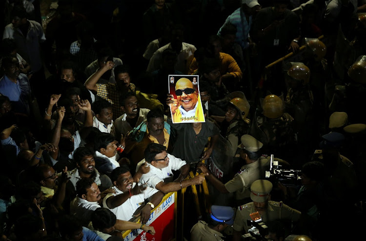 Supporters gather as an ambulance carrying the remains of Indian Tamil leader Muthuvel Karunanidhi leaves the hospital in Chennai, India, August 7 2018. Picture: REUTERS/P RAVIKUMAR