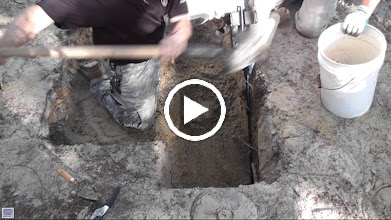 Video: Metal detectors come in handy.  The 'skeleton' has been removed and they are simply checking below where the burial was.