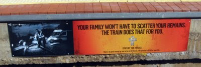 Sign saying a train will scatter your remains if you're on the tracks