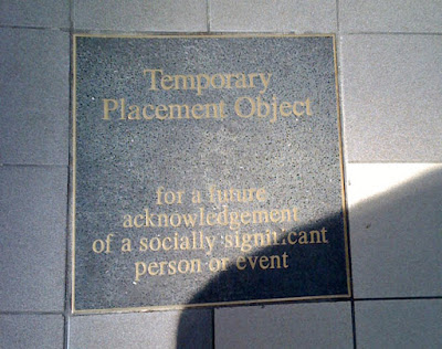 Plaque saying space is reserved for a plaque