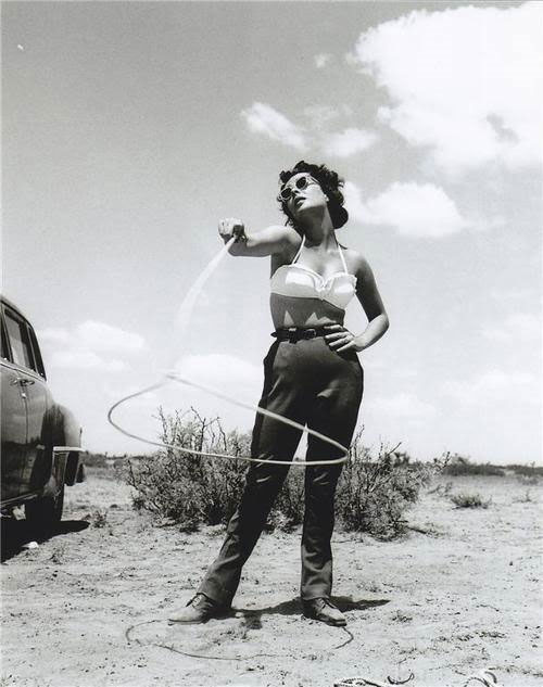Elizabeth Taylor, twirling a lariat in the desert (probably during the filming of Giant (released 1956))