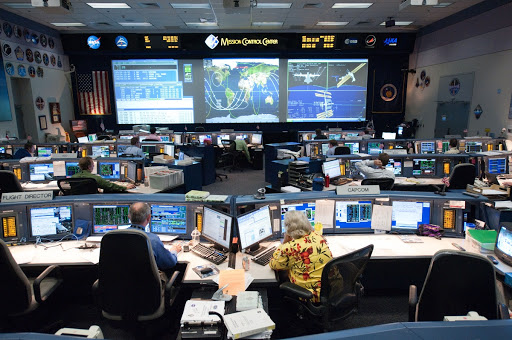 STS-135 Flight Controllers on Console. Orbit 3