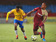 Nicholus Lukhubeni of Mamelodi Sundowns is challenged by Iqraam Rayners of Stellenbosch FC during the Absa Premiership match.