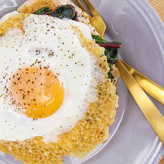 Rachael's Chicken Paillard with Mornay Sauce, Garlicky Greens and Frico Egg.