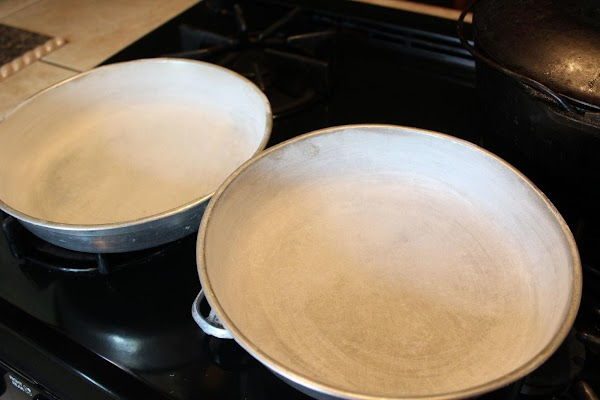 Bake in a 350 degree preheated oven.  Grease and flour 2 9-inch cake pans. I...