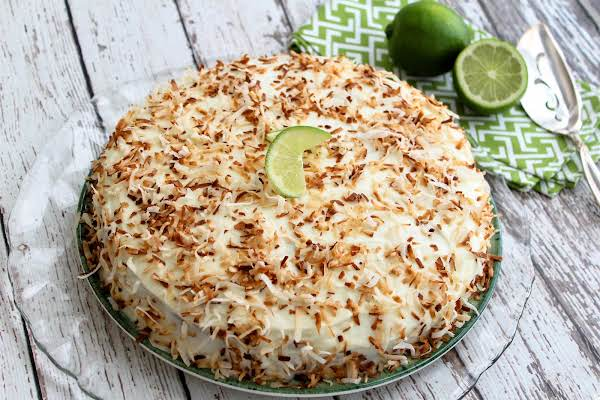Lime And Coconut Cake Frosted And Topped With Toasted Coconut.