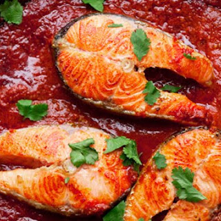 Salmon Steaks with Spicy Tomato Sauce.