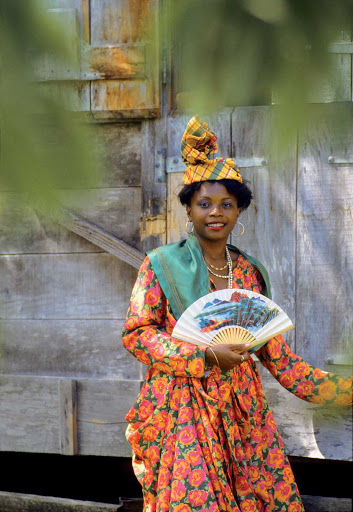 Guadeloupe-woman.jpg - A young woman wears a traditional Creole costume at La Grivelière on Basse Terre, Guadeloupe.