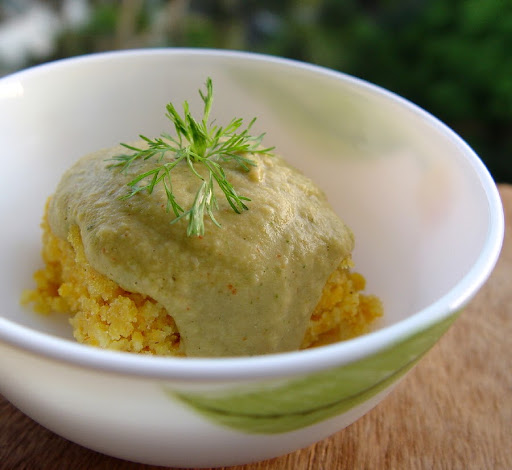 Roasted Garlic and Cilantro Hummus served over fresh, homemade Corn Bread